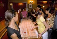 Fun with a Shuffleboard Table at your party or event